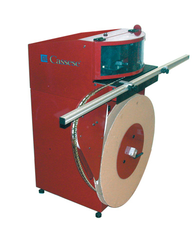 MF 40, High speed coil fed machine to fasten hangers & hinged-hangers, ideal for contract framers & mass production. Fastening activated by a sensor